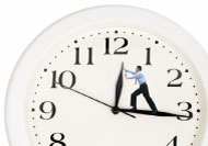 man trying to 'hold back time' on clock face